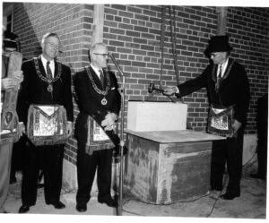 three masons at cornerstone ceremony
